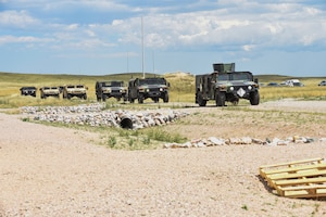 90th Mission Support Group preforms in a tactical convoy exercise during a warrior day Aug. 15, 2019, on F.E. Warren Air Force Base, Wyo. 90th MSG Airmen participated in a hands-on Self Aid Buddy Care training, vehicle familiarization, and tactical convoy and communications. (U.S. Air Force photo by Senior Airman Abbigayle Williams)