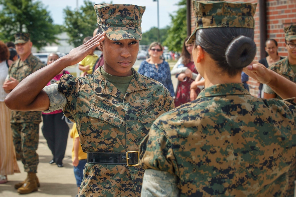 A Marine salutes another Marine.