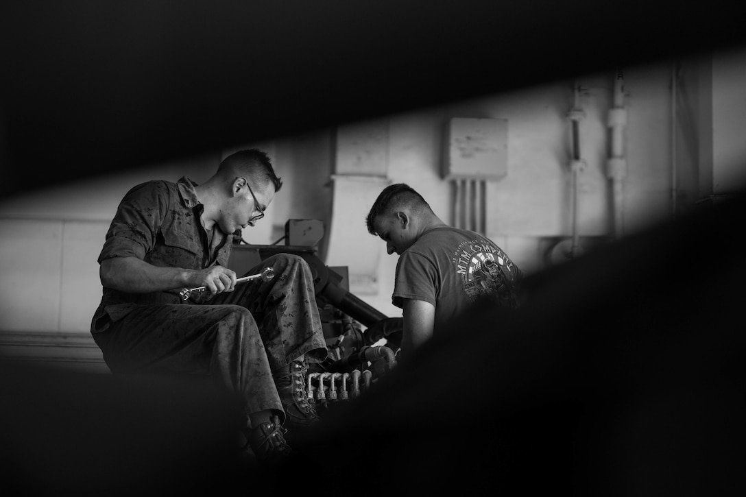 U.S. Marine Corps Cpl. Ian Masoner, left, and Lance Cpl. Logan Pumroy perform corrective maintenance on a manifold assembly on Camp Kinser, Okinawa, Japan, August 16, 2019. The manifold assembly is part of a retrieval system that is attached to a Logistical Vehicle System Replacement. The retrieval system is able to lift and transport large vehicles such as 7-tons and other LVSR's. Masoner, a native of Santa Cruz, California, is a motor transportation technician with Motor Transport Maintenance Company, 3rd Maintenance Battalion, 3rd Marine Logistics Group. Pumroy, a native of Elbert, Colorado, is a motor transportation technician with MTM Co., 3rd Maint. Bn., 3rd MLG.