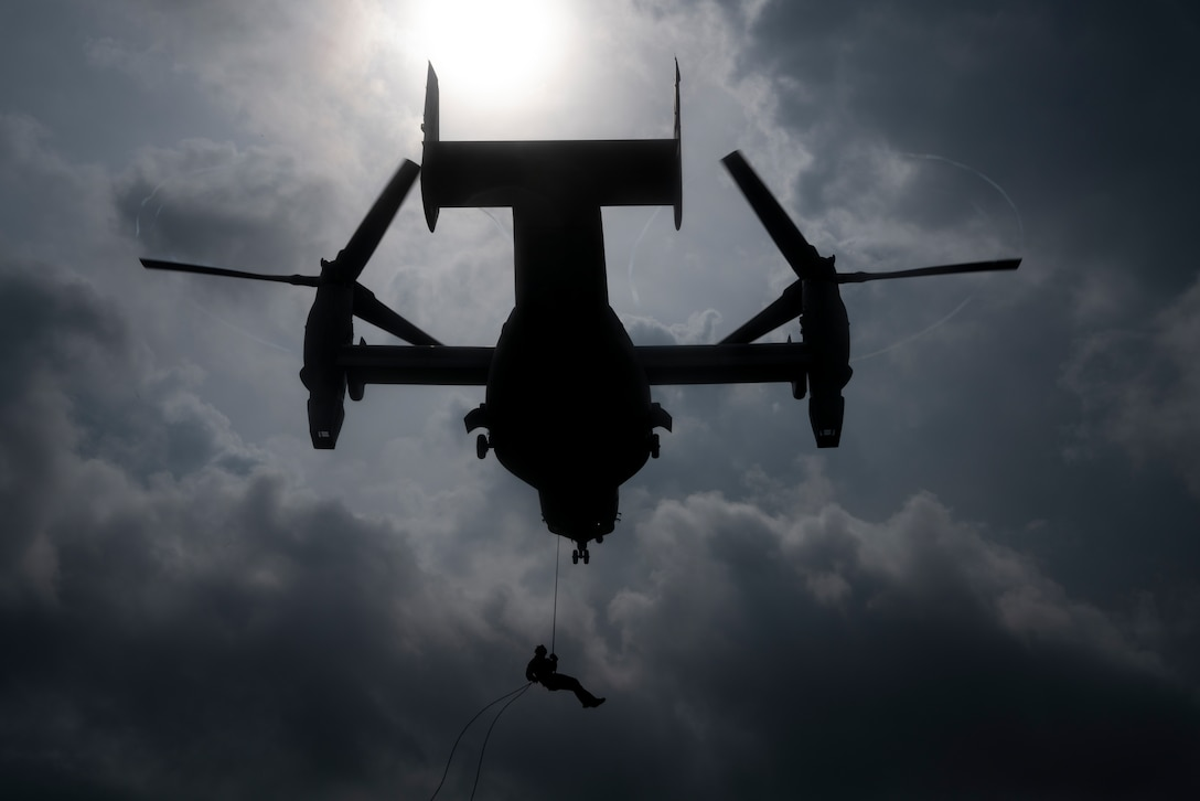 A U.S. Marine with 3rd Reconnaissance Battalion repels out of an MV-22 Osprey during helicopter rope suspension technique training at the parade deck on Camp Hansen, Okinawa, Japan, on Aug. 14, 2019. Marines with 3rd Recon Bn. and Soldiers with 1st Special Forces Group received training from Expeditionary Operations Training Group, III Marine Expeditionary Force Information Group, on HRST, which is the system the Marine Corps uses to insert into an area via hovering aircraft.