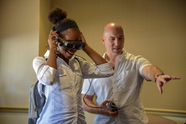 PHILADELPHIA (August 15, 2019) Naval Surface Warfare Center, Philadelphia Division (NSWCPD) engineer Patrick Violante demonstrates augmented reality to a Girl Scout summer camper during the Girl Scouts of Eastern Pennsylvania for their STEM Experience Summer Camp on Aug. 15. Violante works with the Command's Advanced Data Acquisition, Prototyping Technologies and Virtual Environments lab, which focuses on cutting-edge 3-D modeling, scanning, and printing. (U.S. Navy photo by Kirsten St. Peter/Released)