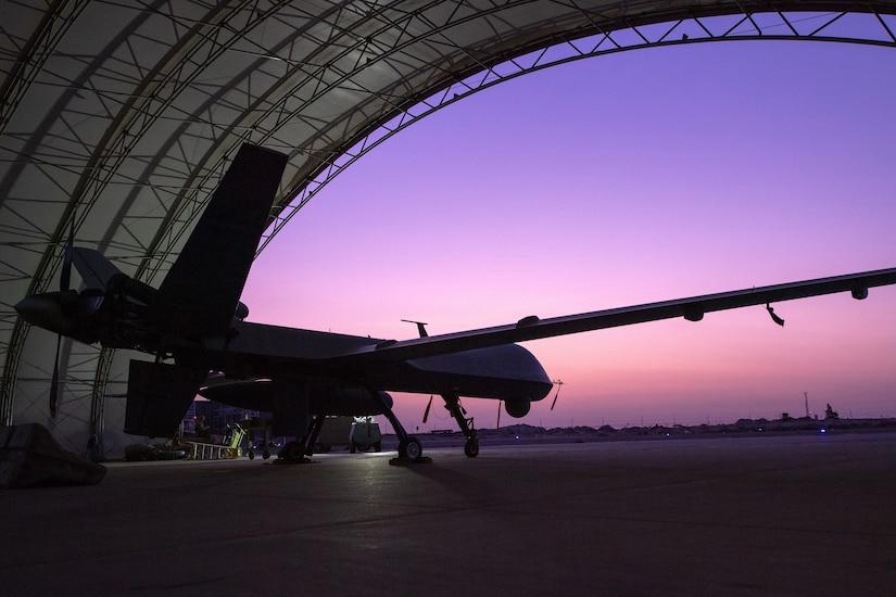An aircraft sits in a hangar.