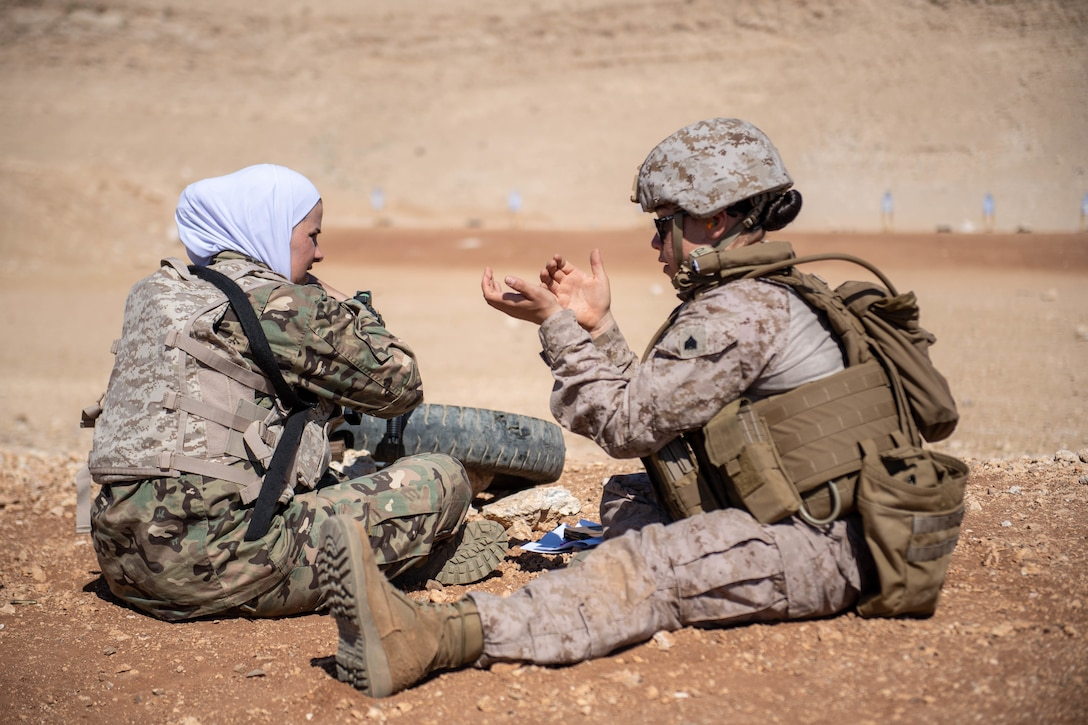 JORDAN Sgt. Dana Rodriguez, assigned to the 11th Marine Expeditionary Unit Female Engagement Team, demonstrates a technique to help stabilize an M4 carbine rifle to a member of the Jordan Armed Forces Quick Reaction Force Female Engagement Team during a live-fire exercise. The Boxer Amphibious Ready Group and the 11th MEU are deployed to the U.S. 5th Fleet area of operations in support of naval operations to ensure maritime stability and security in the Central Region, connecting the Mediterranean and the Pacific through the Western Indian Ocean and three strategic choke points.