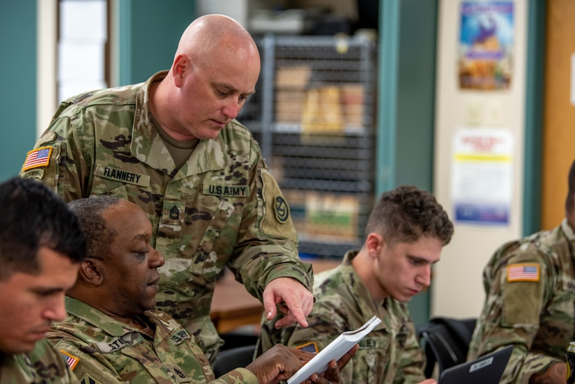 Photo of Sgt. 1st Class Thomas Flannery instructing a class.