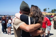 A Marine from Delta Company, 1st Recruit Training Battalion, hugs his loved one after being released for liberty at Marine Corps Recruit Depot, August 15.