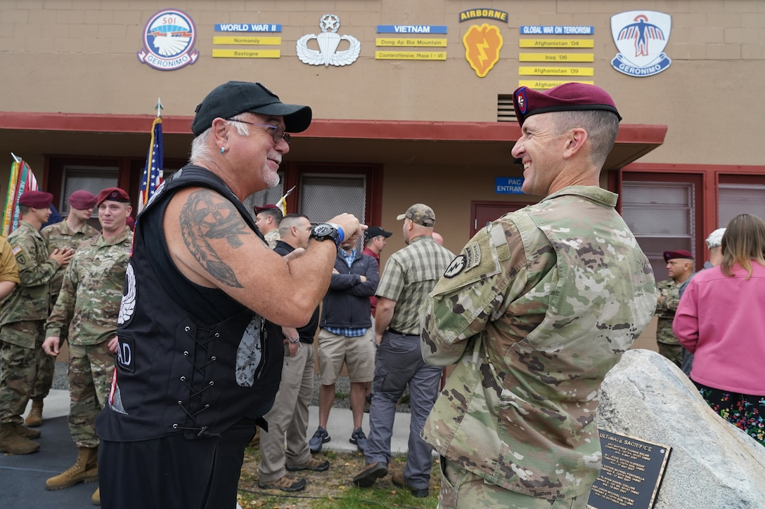 "Retired Army 1st Sgt. Lee ""Scrounger"" Cromwell, of Pinehurst, NC, left, talks with Army Lt. Col. Matt Myer, the commander of 1st Battalion, 501st Parachute Infantry Regiment, 4th Infantry Brigade Combat Team (Airborne), 25th Infantry Division, U.S. Army Alaska, as active-duty paratroopers, veterans of the unit, dependents, and honored guests gather for 'Geronimo Week' festivities on Joint Base Elmendorf-Richardson, Alaska, Aug. 14, 2019, celebrating the unit's lineage. The regiment was activated on Nov. 15, 1942, at Camp Toccoa, Ga., served with distinction in World War II, the Cold War, Vietnam, as well as the Global War on Terror and continues to uphold the high standards expected of an airborne unit in peacetime duties and on the field of battle."