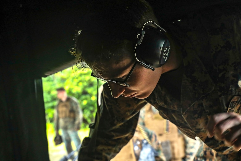 U.S. Marine Corps Cpl. William Baker prepares ammunition during a machine gun range on Range 7, Camp Hansen, Okinawa, Japan, June 20, 2019. During the range, Marines with Communications Company, Combat Logistics Regiment 37, 3rd Marine Logistics Group, trained to improve field communications skills while employing M249 light machine guns, M240B medium machine guns and .50 caliber machine guns. Baker, a native of Bowling Green, Kentucky, is the ammunition chief for CLR-37, 3rd MLG. (U.S. Marine Corps photo by Cpl. Joshua Pinkney)