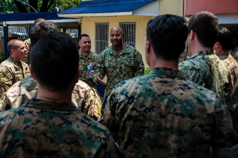 MANILA, Philippines (Aug. 19, 2019) Senior Chief Gunner's Mate Deonta Wade, assigned to Destroyer Squadron 7, speaks with participants during Southeast Asia Cooperation and Training (SEACAT) 2019 at the Philippine Coast Guard Headquarters in Manila. This year marks the 18th iteration of SEACAT, which is designed to enhance maritime security skills by highlighting the value of information sharing and multilateral coordination.