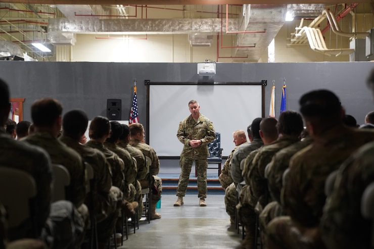 Chief Master Sgt. Christian Hendrick addresses the enlisted members of the 353rd Special Operations Group at an all call on 14 August, 2019.