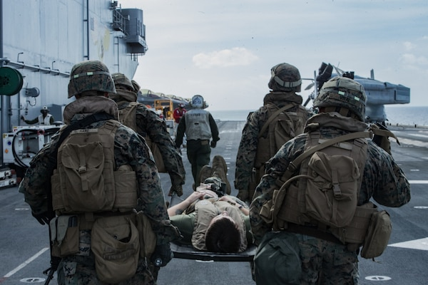 Marines with Combat Logistics Battalion 31, 31st Marine Expeditionary Unit, move a simulated casualty to triage care during a casualty evacuation exercise aboard the amphibious assault ship USS Wasp (LHD 1), underway in the Philippine Sea, June 12, 2019. (U.S. Marine Corps, Isaac Cantrell)