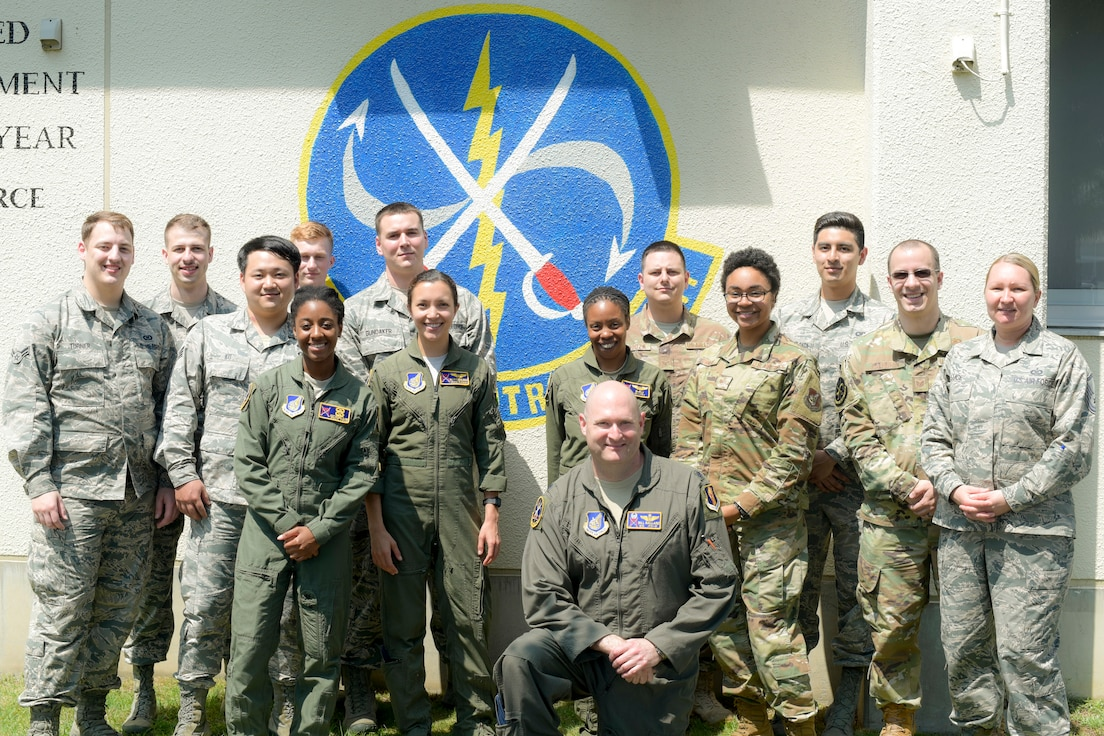 """The U.S. Air Force 610th Air Control Flight pauses for a group photo at Misawa Air Base, Japan, July 31, 2019. The 610th ACF won two Headquarters Air Force-level awards in 2018 including the """"Outstanding Ground-Based Battle Management Command and Control Crew."""" Its mission ensured airspace safety for F-16 Fighting Falcon sorties by de-conflicting with multiple aircraft and providing pilots real-time feedback."""