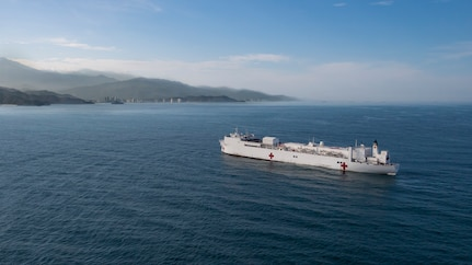The hospital ship USNS Comfort prepares to anchor.