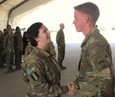 Spc. Kelsey Harty, a paralegal specialist with the 398th Support Battalion, 1st Infantry Division Sustainment Brigade, congratulates Sgt. James Harty, a CH-47 Chinook helicopter repairer with the 2d Battalion, 501st Aviation Regiment, 1st Armored Division, after his promotion to sergeant at Bagram Air Field, Afghanistan, May 1, 2019. Due to the two being deployed in the same location, Kelsey was able to participate in James' promotion ceremony.