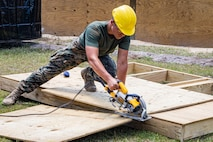 A U.S. Marine with 2nd Combat Engineer Battalion, 2nd Marine Division, saws through wood during a leadership course and bunker construction on Camp Lejeune, N.C., Aug. 13, 2019. The joint construction training between the Navy and the Marine Corps was conducted for the first time in fifteen years, strengthening joint military standards, relationships, and camaraderie. (U.S. Marine Corps photo by Lance Cpl. Kensie S. Milner)