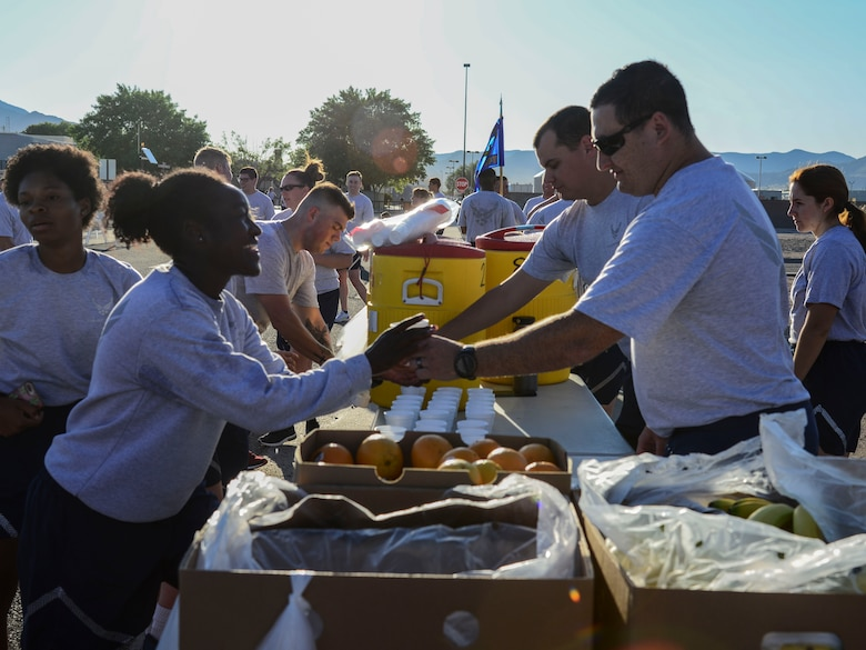 Volunteers hand out water to participants after they complete a Wing Tiger Run at Kirtland Air Force Base, N.M., August 16, 2019.  The Tiger Run is 5-kilometers long and is held quarterly to bring different units of the 377th Air Base Wing together to increase morale and esprit de corps. (U.S. Air Force Photo by Airman 1st Class Kiana Pearson)
