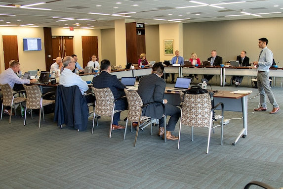 Tony Taylor, U.S. Army Financial Management Command EagleCash program manager, far left, talks about what the Army is doing to prepare to consolidate current Department of Defense stored value cards in to a single card that would be industry compliant, improve security and leverage cost savings through economies of scale during a meeting at the Federal Reserve Bank of Boston May 9, 2019. Army, Navy, Air Force and Marine Corps representatives, along with their U.S. Treasury's Bureau of the Fiscal Service and Federal Reserve Bank counterparts have been meeting quarterly to discuss the consolidation, with software and hardware capable of handling both the current cards and the new-EagleCash deployed around the globe this fall. (U.S. Army photo by Mark R. W. Orders-Woempner)