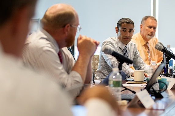 Nadir Isfahani, U.S. Treasury's Bureau of the Fiscal Service stored value cards portfolio manager, second from right, answers a question from Tony Taylor, U.S. Army Financial Management Command EagleCash program manager, far left, as they discuss a plan to merge Army, Marine Corps, Navy and Air Force SVCs into one single card, an EagleCash consolidated card, during a meeting at the Federal Reserve Bank of Boston Aug. 8, 2019. Currently, the Department of Defense uses non-reloadable EZpay cards to optimize training time at initial entry training sites and reloadable EagleCash and Navy Cash cards for deployed personnel to save money and increase security. (U.S. Army photo by Mark R. W. Orders-Woempner)