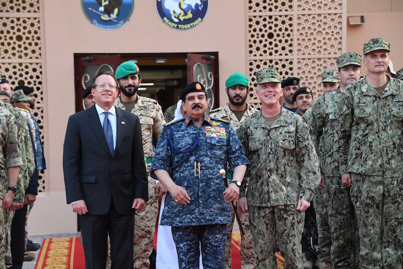 His Majesty, King Hamad bin Isa Al Khalifa, the King of the Kingdom of Bahrain, center, Vice Adm. Jim Malloy, commander of U.S. Naval Forces Central Command, U.S. 5th Fleet, right, and the U.S. Ambassador to the Kingdom of Bahrain, the honorable Justin Siberell, pose for a photo during a visit to discuss operations in the U.S. 5th Fleet area of operations. The King was accompanied by two of his sons, His Highness Maj. Gen. Shaikh Nasser bin Hamad Al-Khalifa, commander of the Bahraini Royal Guard, and His Highness Lt. Col. Shaikh Khaled bin Hamad Al Khalifa, commander of the Bahraini Royal Guard Rapid Intervention Force along with other top Bahraini military leaders. Bahrain has been a partner with the United States in regional maritime security for more than 70 years. (U.S. Navy photo by Mass Communication Specialist 3rd Class Dawson Roth/Released)