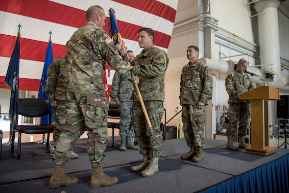Brig. Gen. Jeffrey Wilkinson (center) assumes responsibility as Kentucky's next assistant adjutant general for Air as he receives the Headquarters, Kentucky Air National Guard guidon from U.S. Army Maj. Gen. Stephen Hogan, Kentucky's adjutant general, during a ceremony at the Kentucky Air National Guard Base in Louisville, Ky., Aug. 11, 2019. Wilkinson replaces Brig. Gen. Warren Hurst, who held the post for six years. (U.S. Air National Guard photo by Staff Sgt. Joshua Horton)