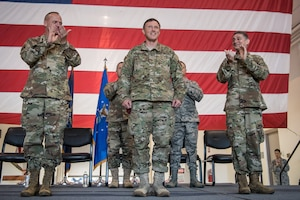 Brig. Gen. Jeffrey Wilkinson (center) assumes responsibility as Kentucky's next assistant adjutant general for Air during a ceremony at the Kentucky Air National Guard Base in Louisville, Ky., Aug. 11, 2019. Wilkinson replaces Brig. Gen. Warren Hurst, who held the post for six years. (U.S. Air National Guard photo by Staff Sgt. Joshua Horton)