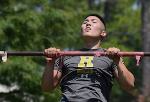 U.S. Air Force 2nd Lt. Brian Lee, 333rd Training Squadron student, completes a pull-up during the 81st Security Forces Squadron Defender's Challenge Ruck near the Crotwell Track on Keesler Air Force Base, Mississippi, Aug. 16, 2019. The competition, consisting of 11 four-person teams, completing seven obstacles, was one of several events in recognition of The Year of the Defender. (U.S. Air Force photo by Kemberly Groue)