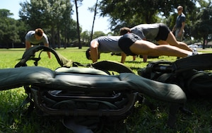 Ruck sacks are displayed on the ground during the 81st Security Forces Squadron Defender's Challenge Ruck near the Crotwell Track on Keesler Air Force Base, Mississippi, Aug. 16, 2019. The competition, consisting of 11 four-person teams, completing seven obstacles, was one of several events in recognition of The Year of the Defender. (U.S. Air Force photo by Kemberly Groue)