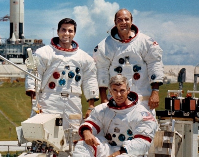 The crew of the final lunar mission, Apollo 17, Mission Commander Navy Capt. Gene Cernan, seated; Command Module Navy Capt. Ronald Evans, left, and Lunar Module Pilot Harrison Schmitt, were in pre-launch quarantine at the Kennedy Space Center, Fla., while their immediate family members were principals of a Protective Service Operation provided by AFOSI. (Courtesy photo)