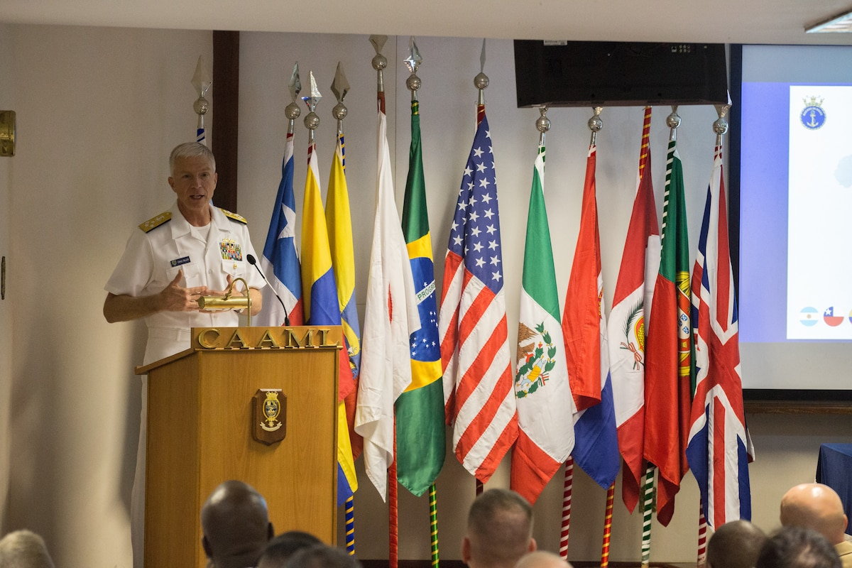 Navy Adm. Craig Faller, commander of U.S. Southern Command, speaks at a podium.