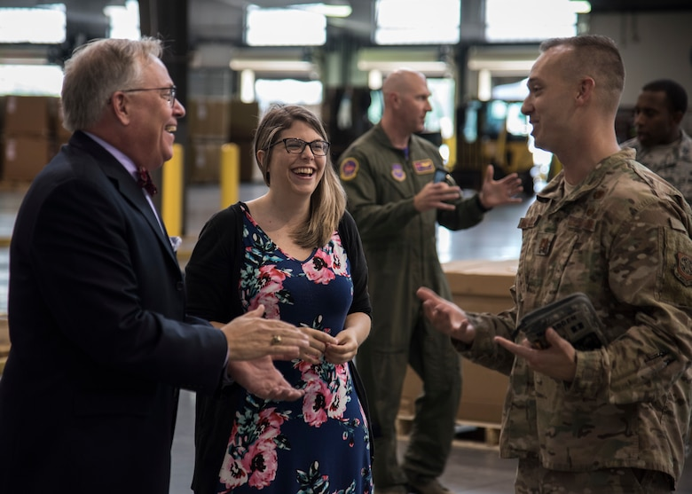 Christopher Cooper, branch head for Naval Sea Systems Command, and Jandi Potts, foreign military sales case manager, share a laugh with Capt. Michael McFadden, operations officer, August 16, 2019, at Dover Air Force Base, Delo. Cooper and Potts visited Dover AFB to praise the Airmen who participated in the joint mission of delivering a torpedo to India. (US Air Force Photo by Airman 1st Class Jonathan Harding)
