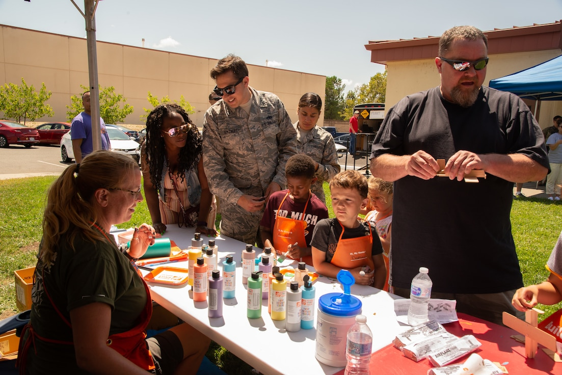 349th Air Mobility Wing Airmen and their family members participate in Operation Family Circle Aug. 10, 2019, at Travis Air Force Base, Calif.