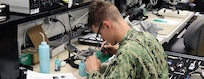Sailor Performs an Assignment on a Circuit Card Assembly