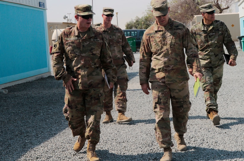 Maj. Gen. Gordon L. Ellis, 38th Infantry Division commanding general, talks with Maj. Ben Washkowiak, 588th Brigade Engineer Battalion operations officer during a tour of Camp Patriot in Kuwait, Tuesday, Aug. 13, 2019. Soldiers with the 38th are in charge of Task Force Spartan, which maintains a U.S. military posture in southwest Asia sufficient to strengthen defense relationships and build partner capacity.