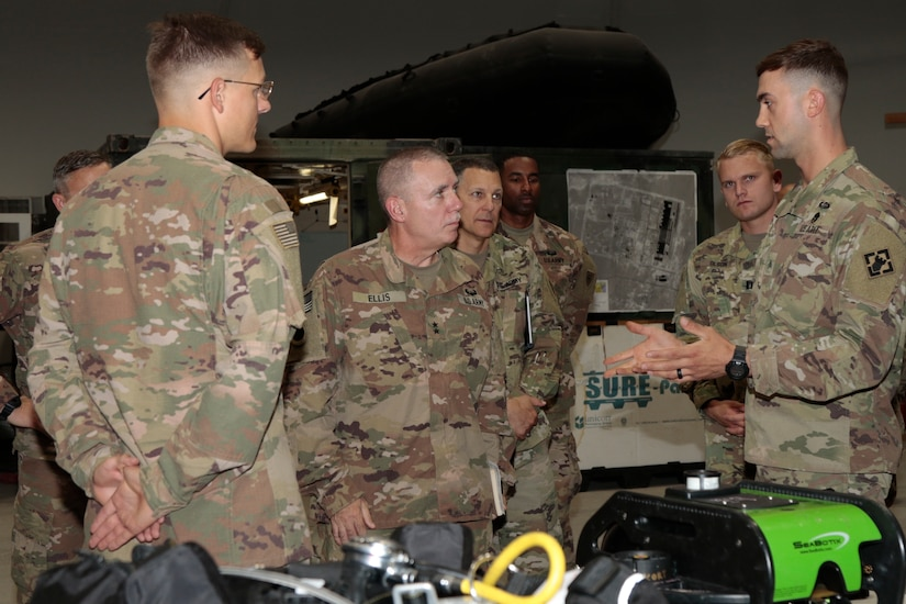 Maj. Gen. Gordon L. Ellis, center, 38th Infantry Division commanding general, talks with Sgt. Michael Pate, a salvage diver with the 511th Engineer Dive Detachment, at Kuwait Naval Base, Tuesday, Aug. 13, 2019. The detachment supports theater-level sustainment and mobility requirements throughout U.S. Army Central in ports, harbors, inland waterways, and littoral zones.