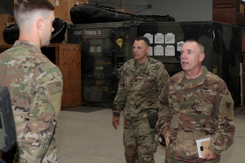 Maj. Gen. Gordon L. Ellis, far right, 38th Infantry Division commanding general, talks with Sgt. Michael Pate, a salvage diver with the 511th Engineer Dive Detachment, at Kuwait Naval Base, Tuesday, Aug. 13, 2019. The detachment supports theater-level sustainment and mobility requirements throughout U.S. Army Central in ports, harbors, inland waterways, and littoral zones.
