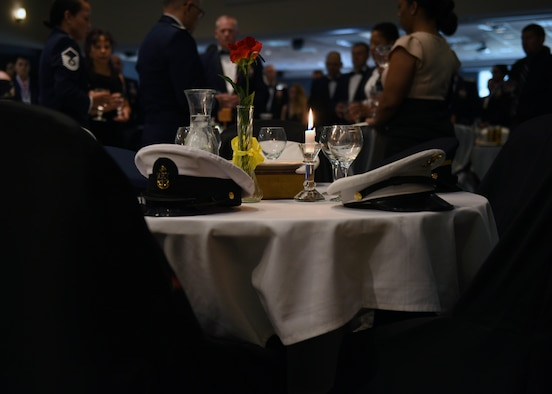 The POW/MIA table is set by the base honor guard during the Senior Noncommissioned Officer Induction Ceremony at the event center on Goodfellow Air Force Base, Texas, August 16, 2019. The table is a symbol to honor and remember America's prisoners of war and missing comrades across all branches. (U.S. Air Force photo by Airman 1st Class Robyn Hunsinger/Released)