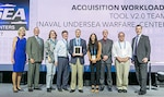 The Naval Undersea Warfare Center Division Newport's Acquisition Workload Planning Tool Version 2.0 Team was awarded the Innovation in Contracting Award from the National Contracts Management Association during an NCMA World Congress award ceremony held July 30 the Hynes Convention Center in Boston, Massachusetts. Team members include Noel Roberts (second from left), Kelly Ross, Mark Snyder, Ryan Lord, Sofia Sinclair, Scott Wentzel, Steve Zbyszewski and Debra Young (not pictured). The award was presented by Debra Scheider (far left), NCMA president, and Kraig Conrad (far right), NCMA CEO.