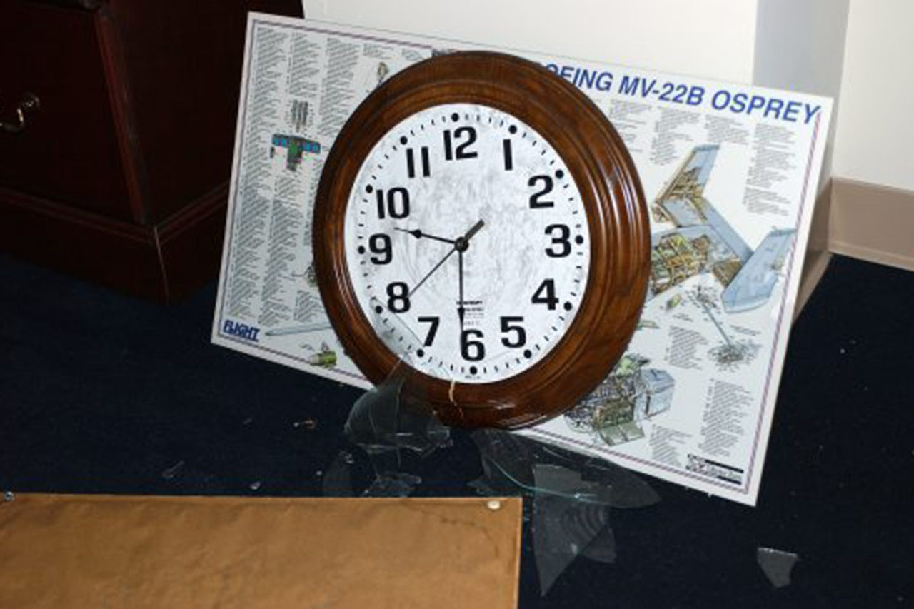 A clock sits on a desk.