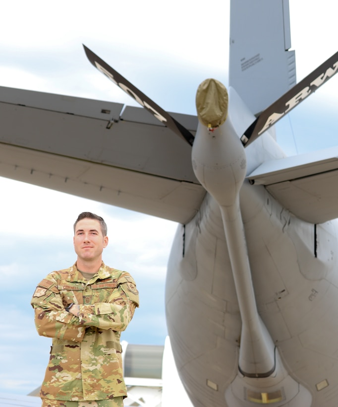 Master Sgt. Ryan Cornell, 465th Air Refueling Squadron boom operator, stands by a 507th Air Refueling Wing KC-135R Stratotanker, Aug. 13, 2019, at Tinker Air Force Base, Oklahoma. The Air Force Recruiting Service was there to film Cornell to highlight enlisted aircrew career fields. (U.S. Air Force photo by Senior Airman Mary Begy)