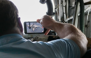 Rep. Kevin Hern snaps a photo of a 138th Fighter Wing F-16 Fighting Falcon preparing to receive fuel from a 507th Air Refueling Wing KC-135R Statotanker during a congressional orientation flight, Aug. 15, 2019, at Tinker Air Force Base, Oklahoma. The Okies shared the Reserve mission and a unique experience with the congressional delegation.(U.S. Air Force photo by Senior Airman Mary Begy)