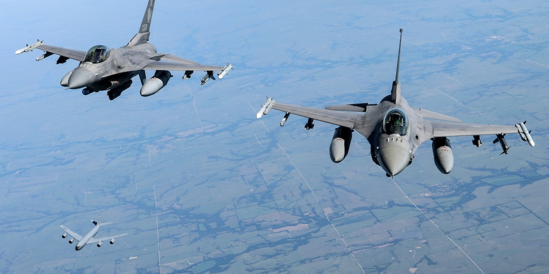 Two 138th Fighter Wing F-16 Fighting Falcons and a 507th Air Refueling Wing KC-135R Statotanker fly behind 507th ARW tanker during a congressional orientation flight, Aug. 15, 2019, at Tinker Air Force Base, Oklahoma. The Okies shared the Reserve mission and a unique experience with the congressional delegation. (U.S. Air Force photo by Senior Airman Mary Begy)