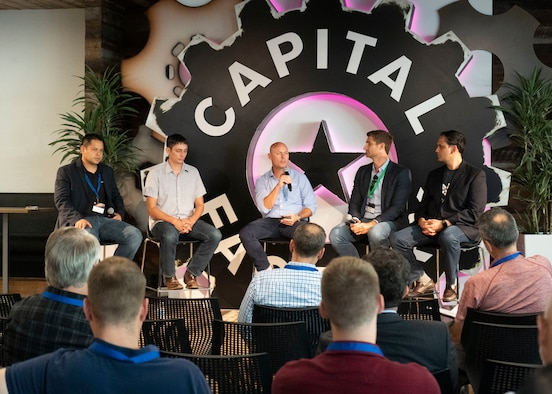 Kevin Landtroop, Capital Factory venture partner, speaks on a panel about the symbiosis between startups, government, and venture capital during the first-ever Spark Collider at the AFWERX Austin Hub Aug 14, 2019. The event connected approximately 100 Phase I Small Business Innovation Research companies and Airmen from about 50 bases to potentially solve Air Force problem areas. (U.S. Air Force photo by Staff Sgt. Jordyn Fetter)