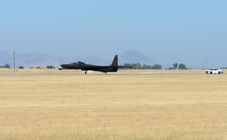 A U-2 Dragon Lady performs a touch and go with a chase car following June 20, 2018, at Beale Air Force Base, California. The driver of the chase car is in constant contact with the U-2 pilot to help him safely land the aircraft.