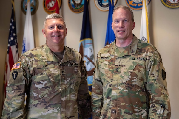 "Army Maj. Gen. Greg Mosser, commanding general of the 377th Theater Sustainment Command, poses with Joint Task Force Civil Support (JTF-CS) Commanding General Army Maj. Gen. William ""Bill"" Hall during a recent visit to JTF-CS's headquarters."