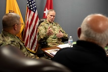 """Army Maj. Gen. Greg Mosser, commanding general of the 377th Theater Sustainment Command, meets with Joint Task Force Civil Support (JTF-CS) Commanding General Army Maj. Gen. William """"Bill"""" Hall and other department heads from the command during a recent visit to JTF-CS's headquarters."""