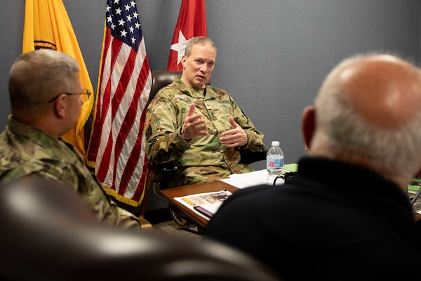 "Army Maj. Gen. Greg Mosser, commanding general of the 377th Theater Sustainment Command, meets with Joint Task Force Civil Support (JTF-CS) Commanding General Army Maj. Gen. William ""Bill"" Hall and other department heads from the command during a recent visit to JTF-CS's headquarters."