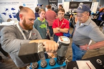 PSNS & IMF employees view a demonstration of tools during a technology showcase hosted by the National Center for Manufacturing Science at the Kitsap Conference Center July 25. More than 50 companies displayed equipment, tools, supplies and safety gear to more cost-effectively and efficiently help shipyard workers maintain, modernize and retire the Navy's fleet.