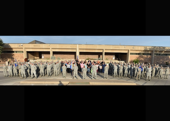 The 17th Medical Group forms in front of the base clinic after the reorganization ceremony at the Ross Clinic on Goodfellow Air Force Base, Texas, August 15, 2019. The reorganization ceremony was to show the re-designation of one squadron and the inactivation and activation of the second squadron. (U.S. Air Force photo by Senior Airman Seraiah Wolf/Released)