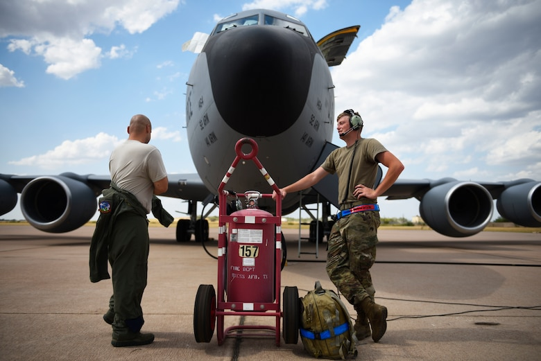 U.S. Air Force Tech. Sgt. Norbert Roland (left) and Senior Airman Zachery Murray (right), 92nd Aircraft Maintenance Squadron flying crew chiefs, prepare for pre-flight checks on a KC-135 Stratotanker at Dyess Air Force Base, Texas, Aug. 13, 2019.
