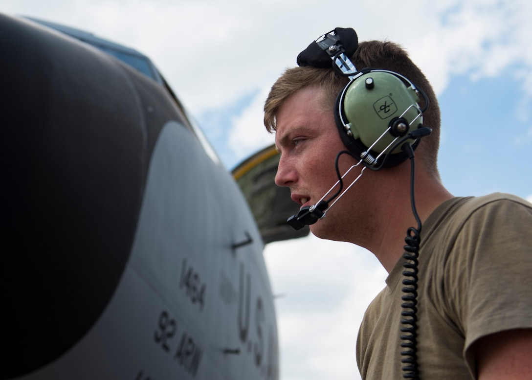 U.S. Air Force Senior Airman Zachery Murray, 92nd Aircraft Maintenance Squadron flying crew chief, communicates with aircrew during pre-flight checks on a KC-135 Stratrotanker at Dyess Air Force Base, Texas, Aug. 13, 2019.