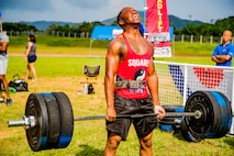 U.S. Marine Corps Lance Cpl. Benjamin Tanner, a radio operator with 3rd Marine Division, deadlifts during the wheelbarrow deadlift scramble event in Okinawa's Strongest Battle of the North, Aug. 18, 2019, Camp Hansen, Okinawa, Japan. The competition challenges men and women to compete in physically demanding events to find the strongest on the island.